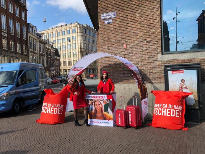 Medewerkers van Enschede Promotie zaterdag in Amsterdam.