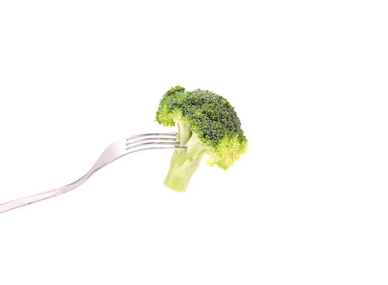 Fresh broccoli on a fork. White background. Beeld colourbox