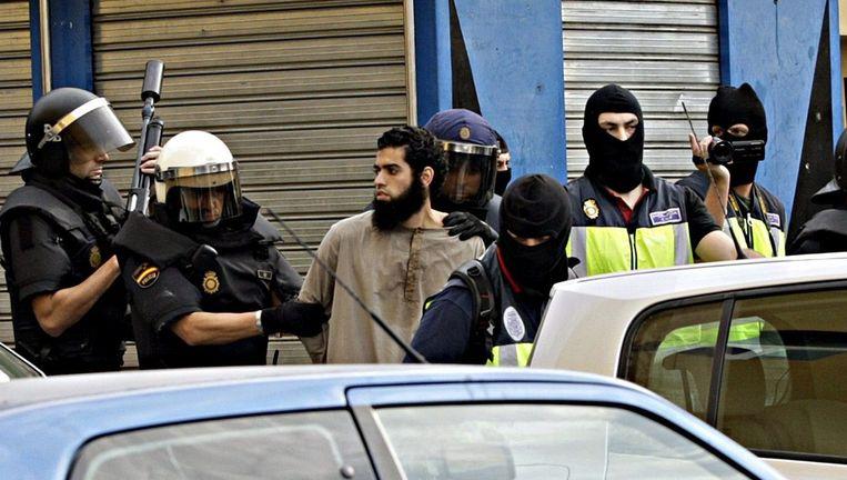 Een van de vandaag gearresteerde mannen in Melilla. Beeld epa