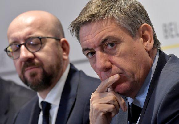 De huidige premier Charles Michel (MR) en Jan Jambon (R)