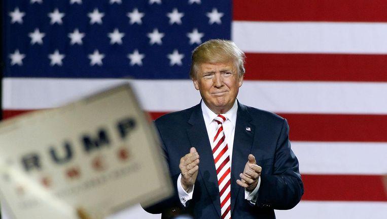 Donald Trump op een campagnebijeenkomst. Beeld getty