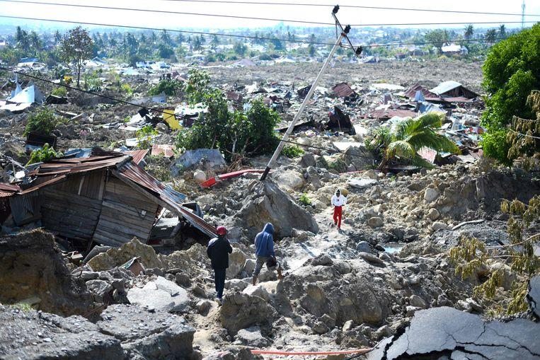 Verwoeste woningen in Palu. Beeld AFP