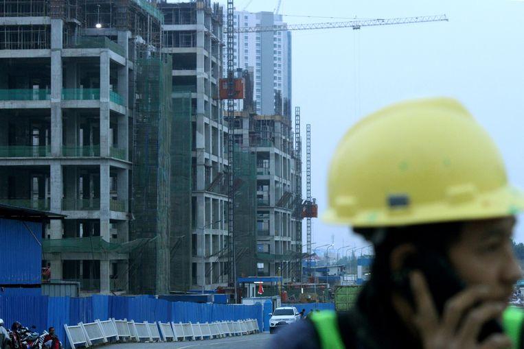 Meikarta in aanbouw. Voorlopig is de stad nog een fata morgana. Beeld Reuters