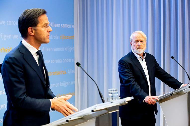 Premier Rutte en Jaap van Dissel tijdens een persconferentie in april. Beeld BSR Agency