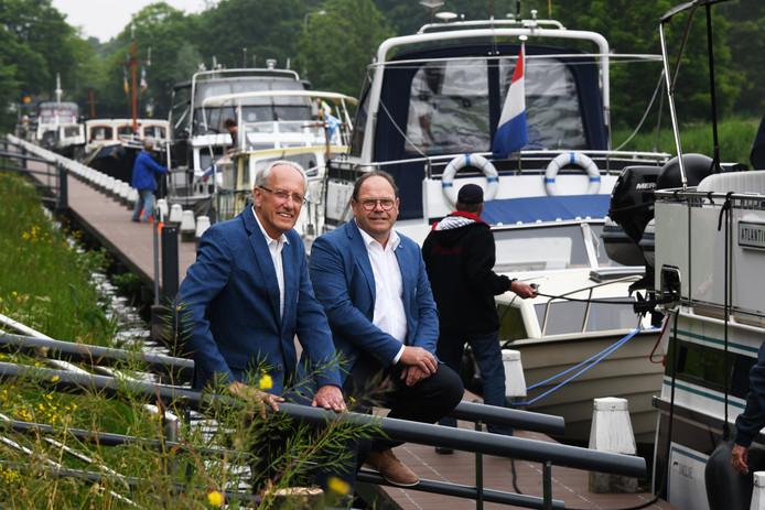 Henk Lammertink en Anné Middendorp van het Sleepbootcomité zien de woningbouw op Sluiseiland als grootste bedreiging voor de Sleepbootdagen in Vianen.