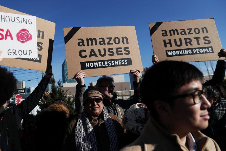 Demonstranten protesteerden deze maand nog tegen de komst van Amazon naar New York. Beeld REUTERS