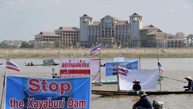 Protesten in de Mekong rivier. Beeld EPA