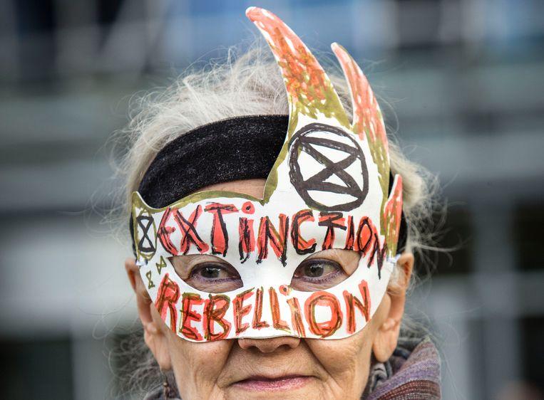 In Rotterdam werd gisteren gedemonstreerd tegen klimaatverandering tijdens de Wereldhavendagen. De Rotterdamse haven is volgens de organisatoren van de mars verantwoordelijk voor bijna een vijfde van de Nederlandse CO2-uitstoot. Beeld Arie Kievit