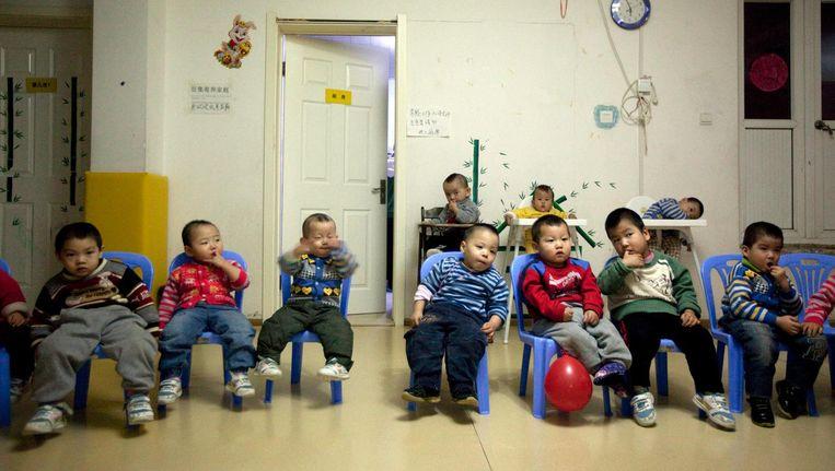 Chinese kinderen in een kindertehuis. Beeld epa