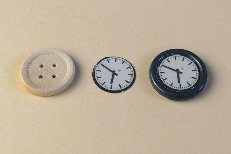 Een klok van een knoop. Beeld