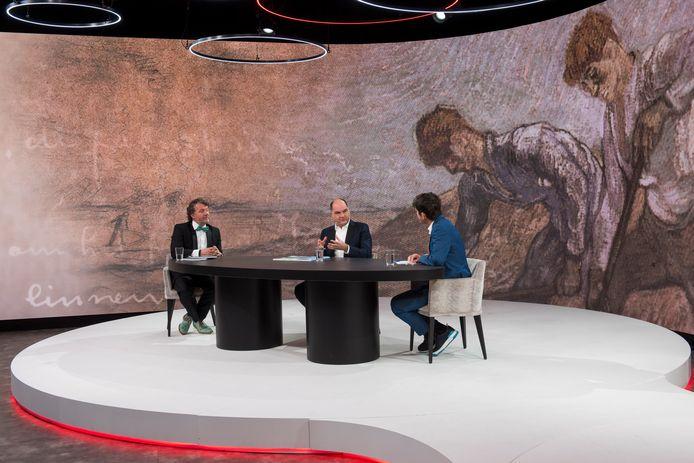 Cornald Maas (rechts) voert een gesprek met Frank van den Eijnden (midden) en Jeroen Veldkamp over de film.