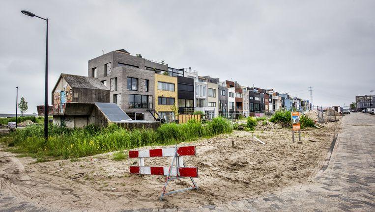 Zelfbouwwoningen op het Zeeburgereiland, een nieuwe woonwijk in Amsterdam. Beeld Raymond Rutting/de Volkskrant